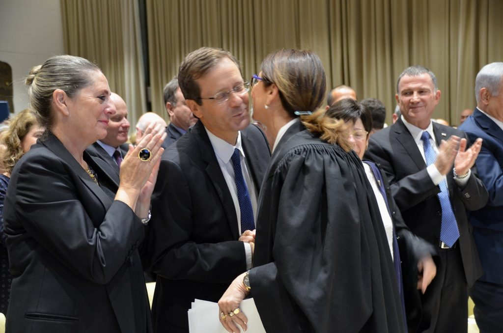 Herzog and Hayut kiss at Beit Hanasi ceremony