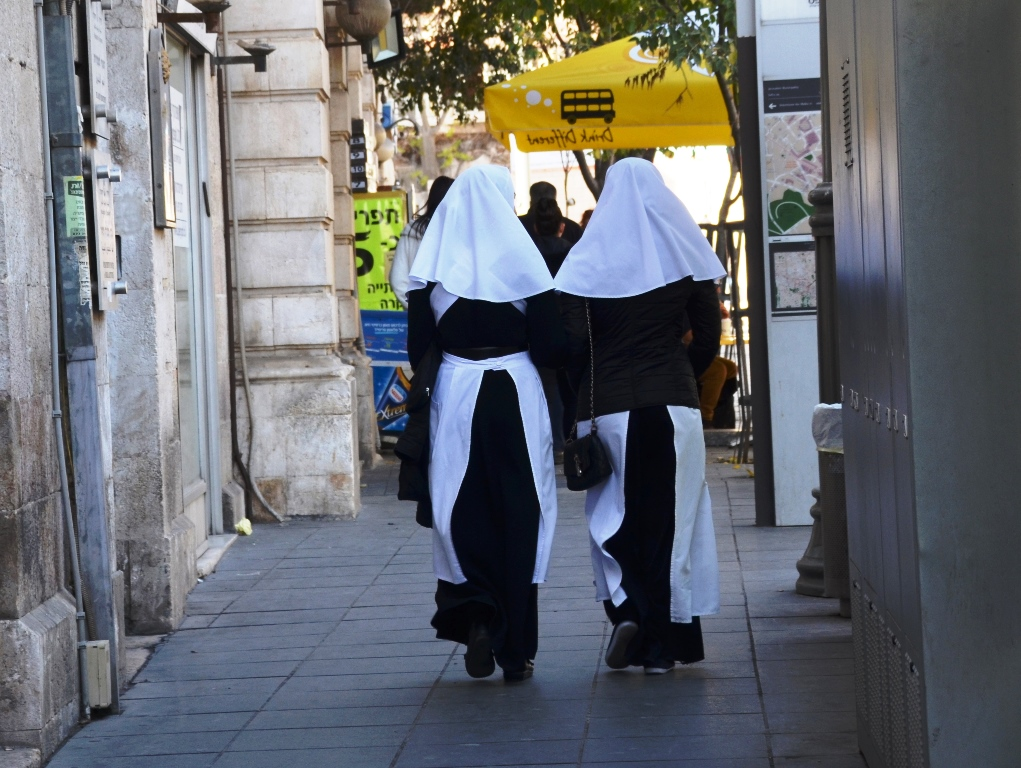 On Jaffa Road two nuns in traditional habits walk by