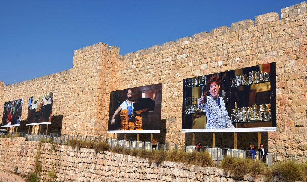 Large photos of Jerusalem faces near Jaffa Gate