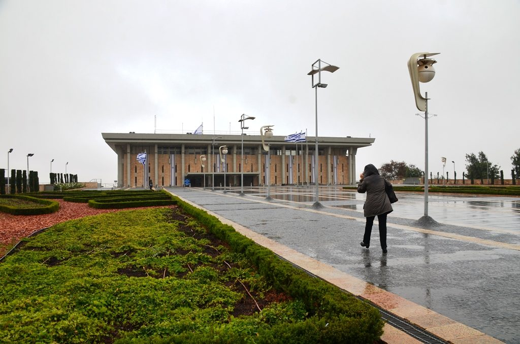 Knesset building on cloudy rainy day