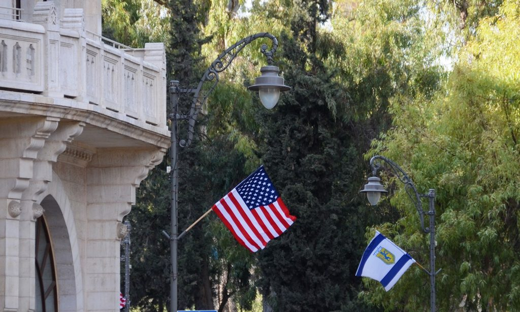US flags flying in Israel on street where US consulate is located.