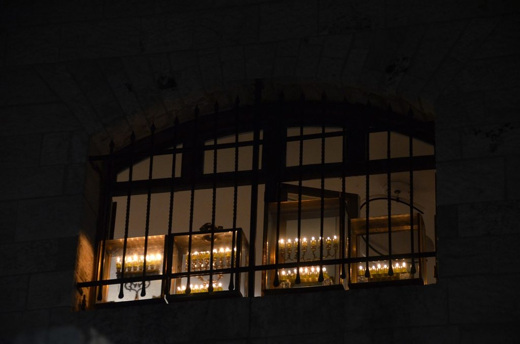 Chanukiot in window in Old City