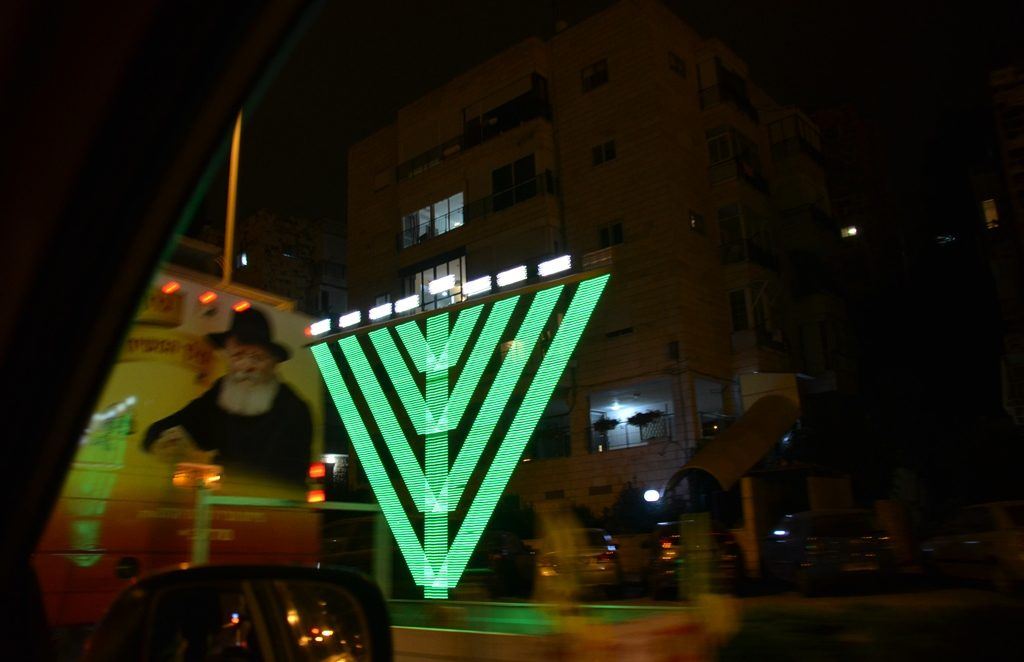 large colorful chanukia in Jerusalem part of Chabad show