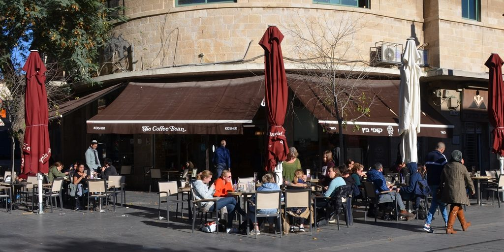 Outside cafe along light rail line on Jaffa Road on sunny day