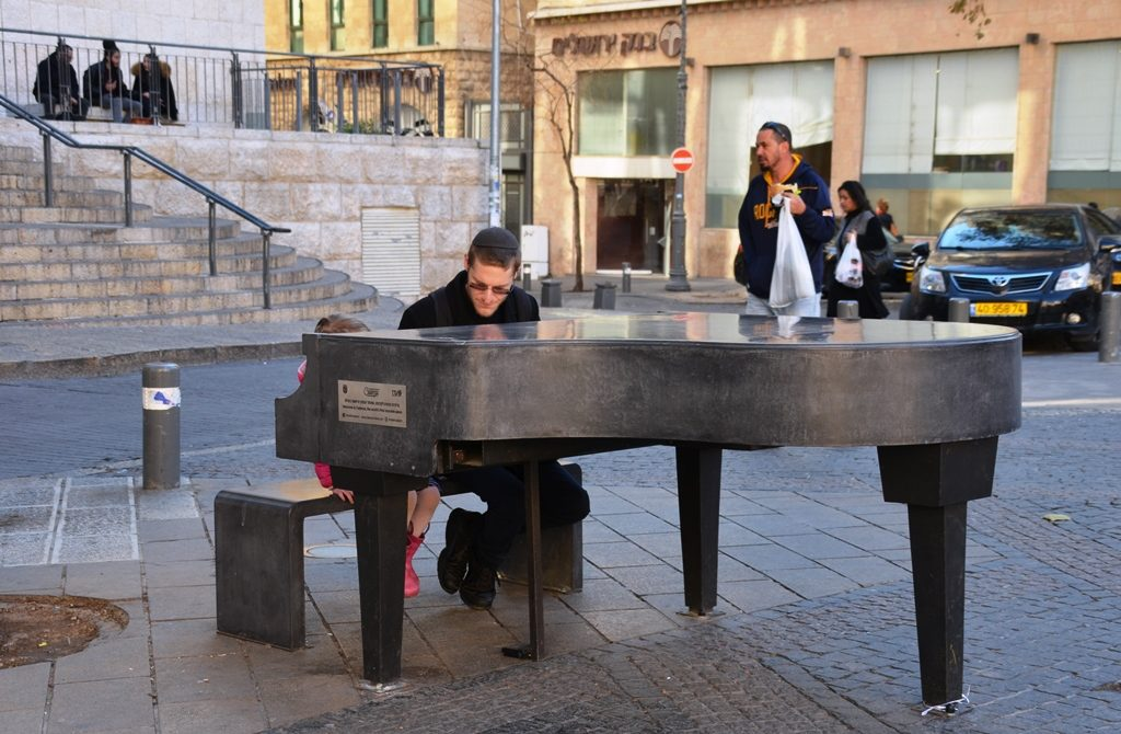 Public square piano with man and little girl Jerusalem, Israel