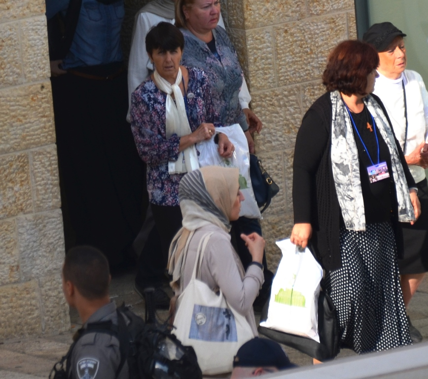Arab girl at Western Wall Plaza alone waiting for friends to come from toilets