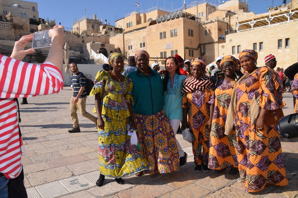 Tourists from Nigeria pose for photo in Jerusalem Old City Western Wall Plaza