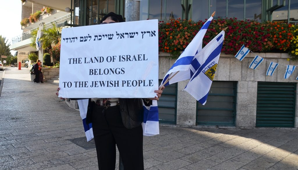 Pro-Israel supporter with sign in Jerusalem Israel