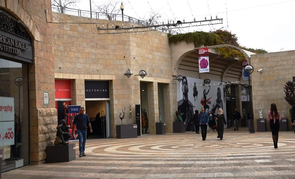 Arab man and woman walk through Mamilla Mall in Jerusalem Israel