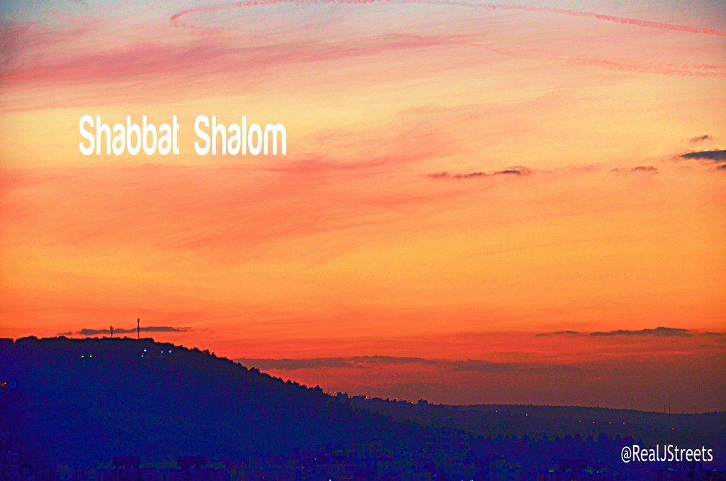 Shabbat Shalom sign with red sumset
