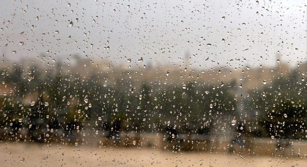 Walls of Old City seen through rain covered window at Begin Center Jerusalem Israel