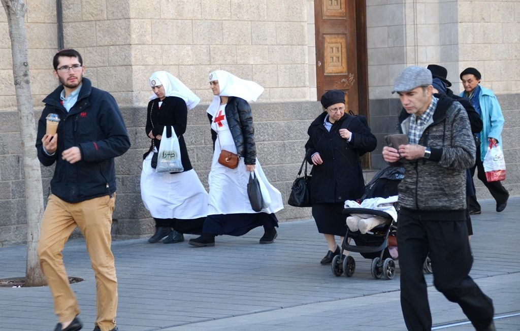 Jerusalem Israel two nuns walking along street near Kikar Safra