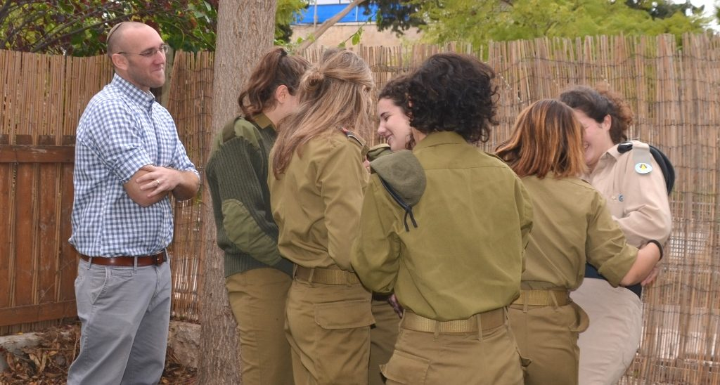 "Female lone soldiers in special residence in Jerusalem group hug ""Mom"" counselor in charge"
