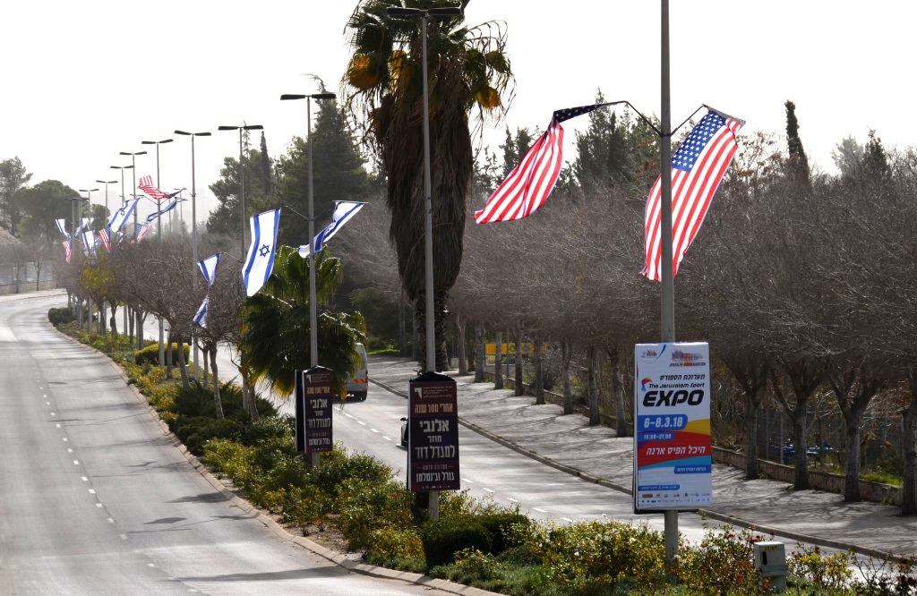 US and Israeli flags on street near Knesset