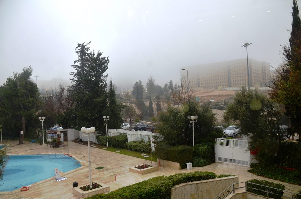 Fog covering Jerusalem buildings.