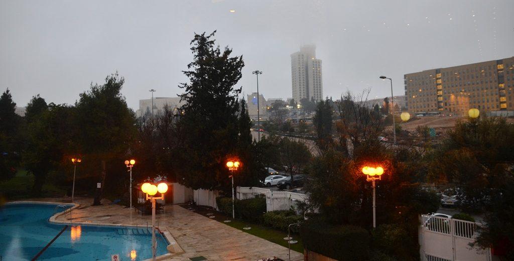 Sunset, lights go on and fog clears Jerusalem Israel rainy day