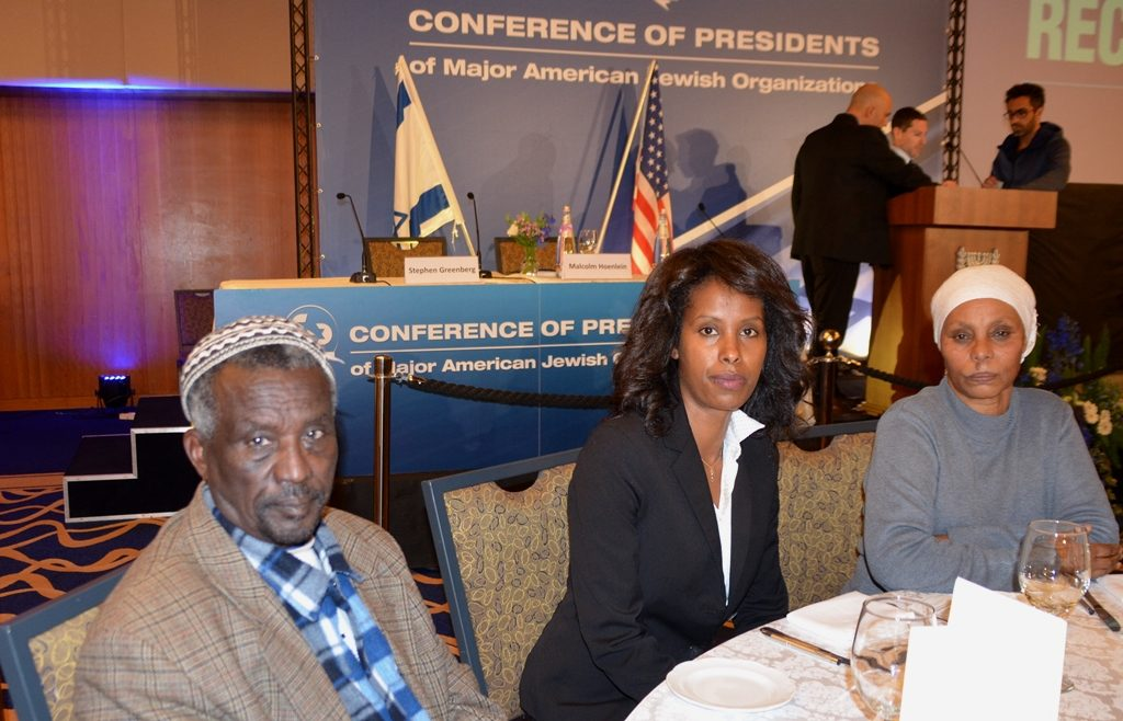 Parents of Avera Mengistu at dinner CoP to raise awareness of their son held captive 3 years by Hamas