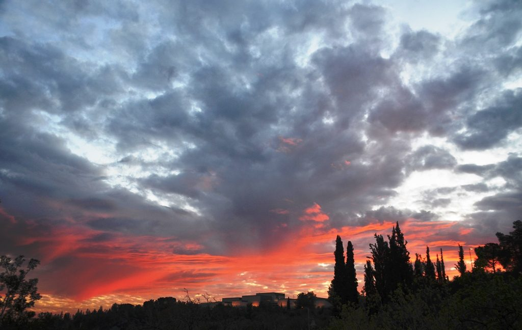 Clouds and colored sky photo Jerusalem sunset over Israel Museum