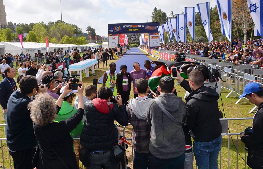 Jerusalem Mayor Nir Barkat with elite runners Jerusalem marathon 2018