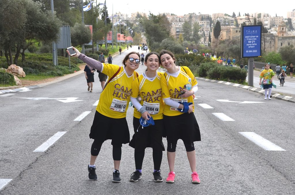 Jerusalem Marathon 10 K race three girls walking to Gan Sacher
