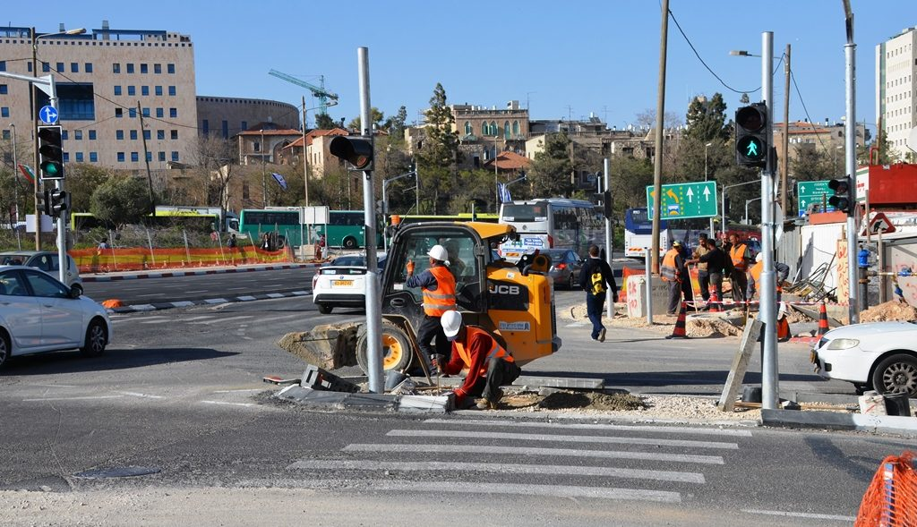 Jerusalem street construction fixing crossings.