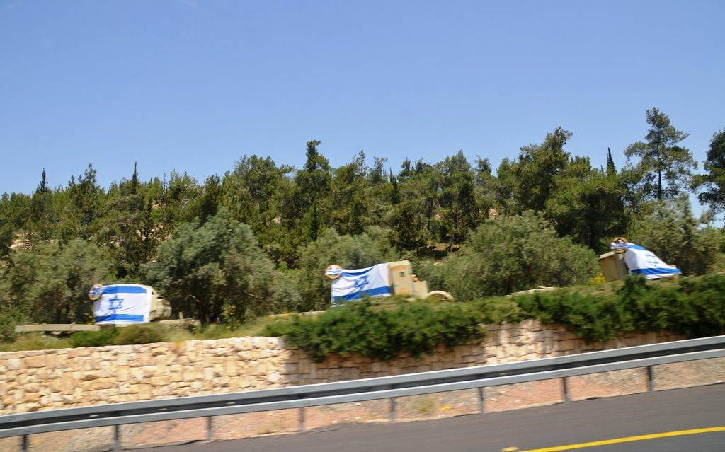 Israeli flags on old vehicles along Route #1 to Jerusalem for Yom Haatzmaut
