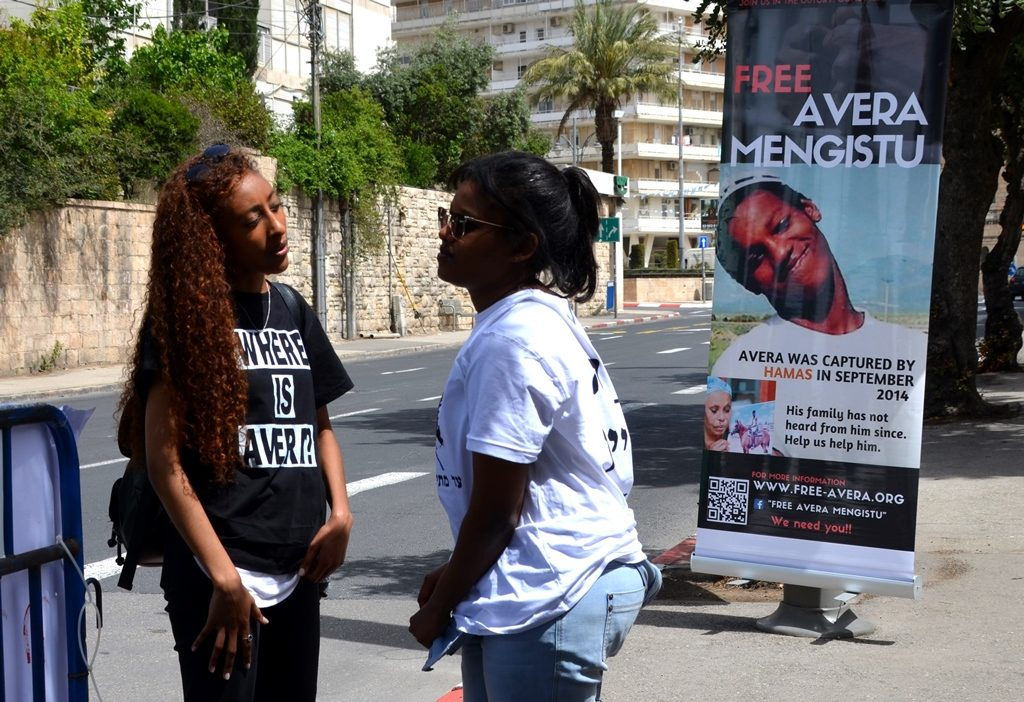 Free Avera Mengistu shirts and signs in Jerusalem Israel