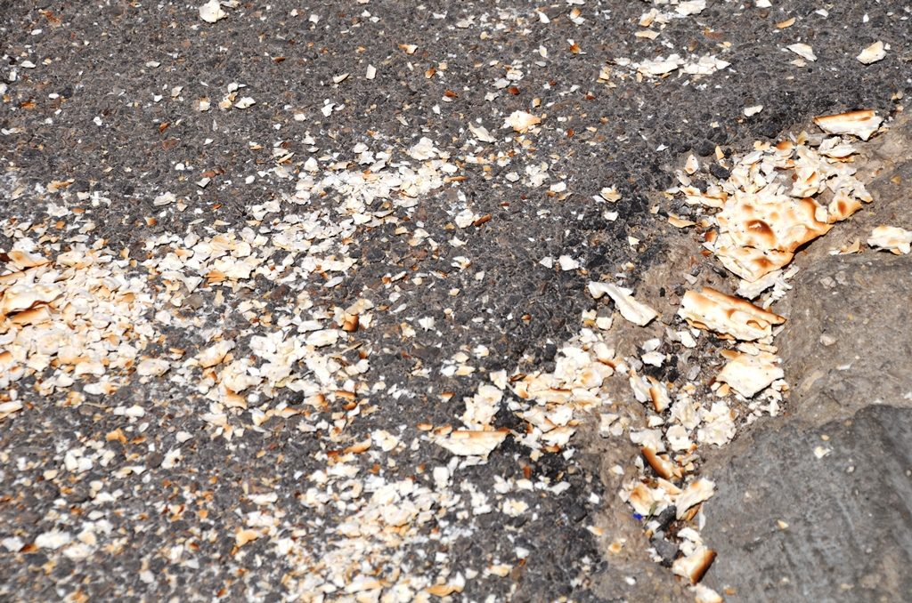 Matzah crumbs on Jerusalem street end of Passover in Israel