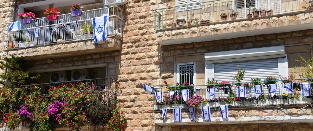 Israel flags on apartment building for Israel 70