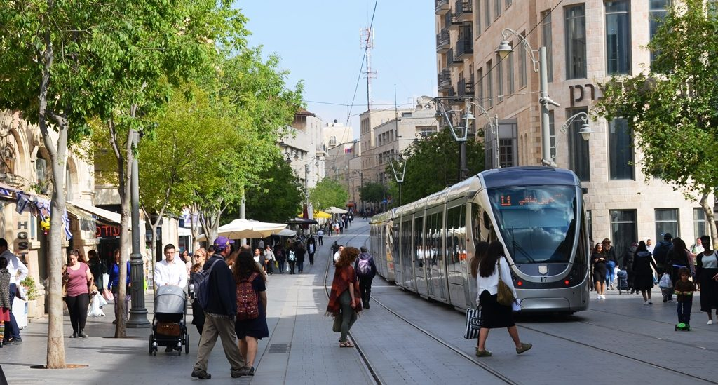 Light rail train and people out in Jerusalem on Jaffa Street near Zion Square