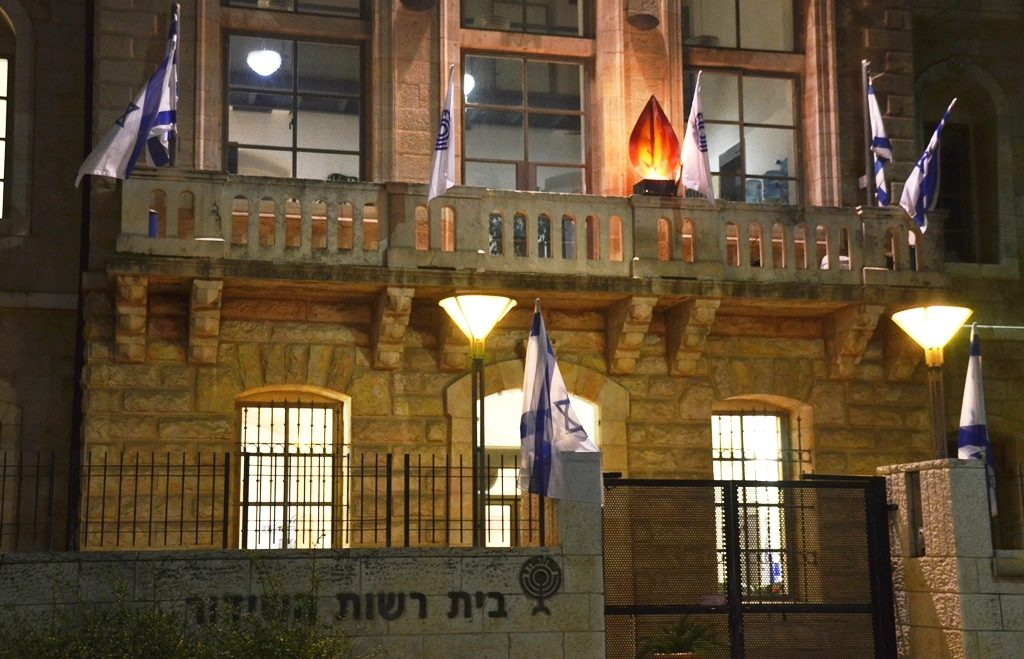 Israeli flags and memorial light for Yom HaZikaron