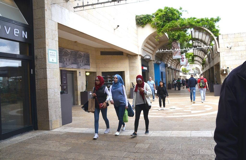 On Jerusalem Day three Muslim girls walk in Mamilla Mall