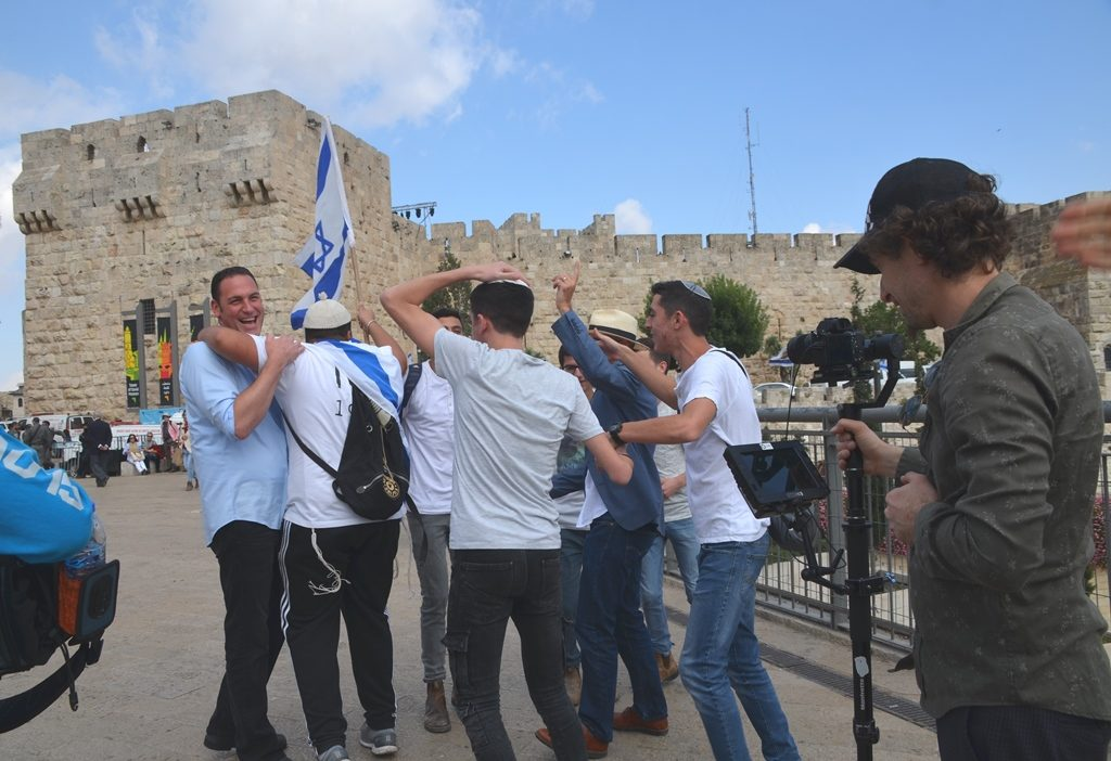 Jerusalem Day Israeli boys interrupt filming of Watchman episode by Erick Stakelbeck near Jaffa Gate.