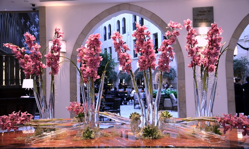 Jerusalem Waldorf Astoria lobby flowers are pink orchids
