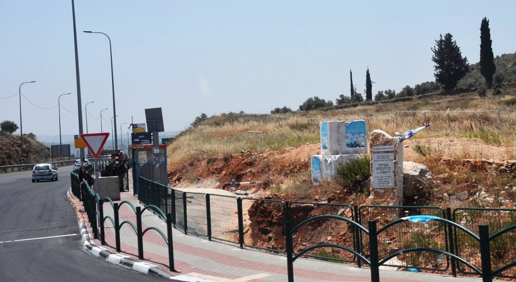 Security barriers to protect those waiting for bus in Shomron