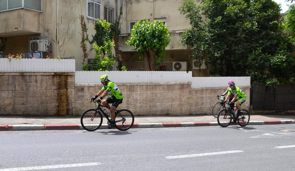 NFNY cyclists on road in Jerusalem