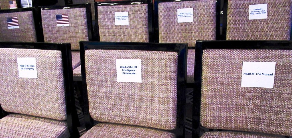 Names of Israel security on chairs at conference in Jerusalem