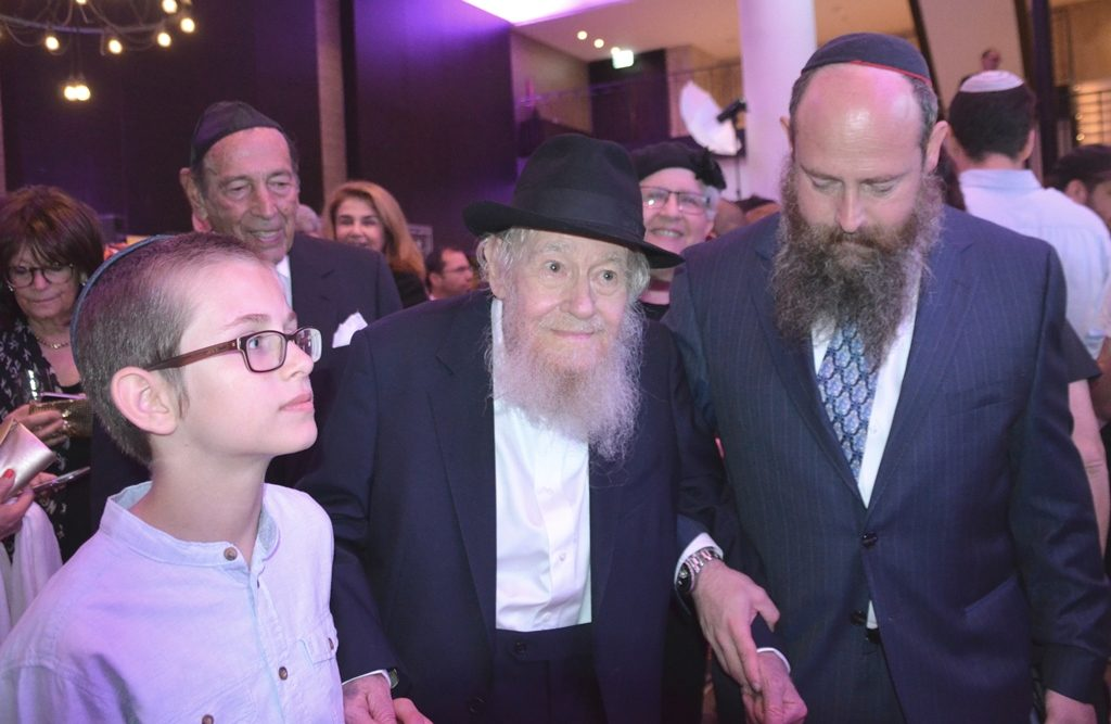 Rav Adin Steinsaltz with son and grandson enter gala tribute for his 80th birthday in Jerusalem Israel