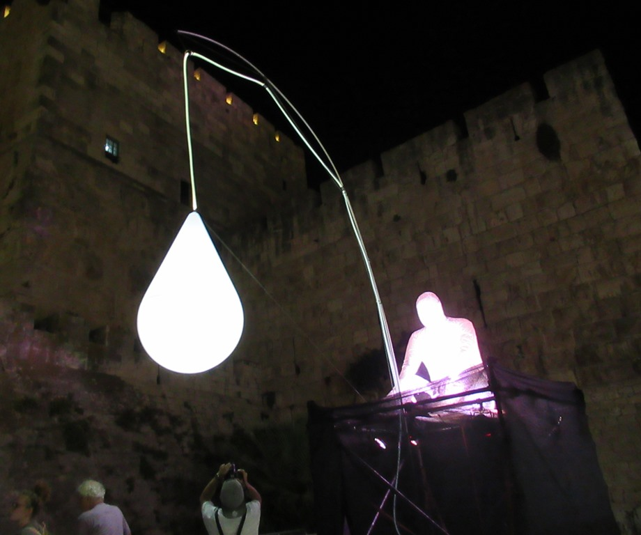 Jerusalem Light Festival in Old City man taking a photo