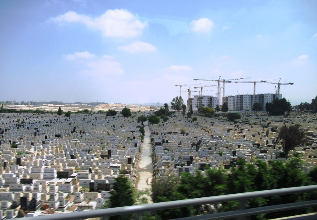 Israeli cemetery with new apartments being built near by