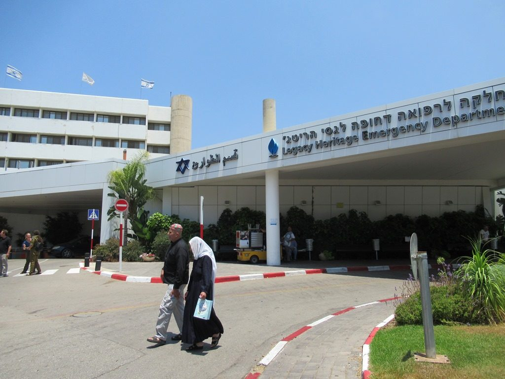 Arab couple walking outside Galilee Medical Center