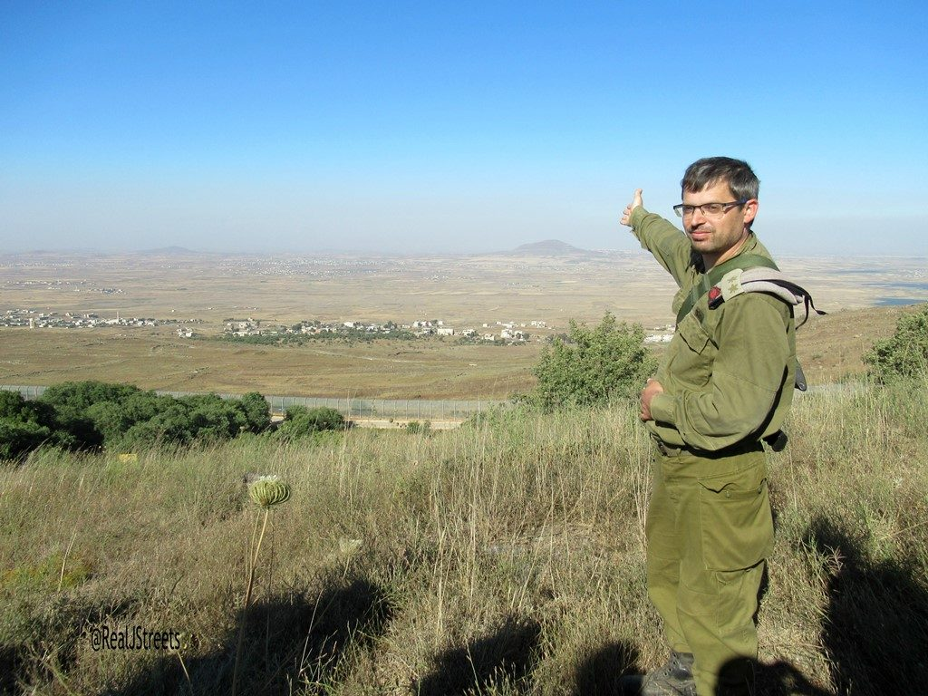 Head of IDF medical unit in Golan Heights pointing to Syria
