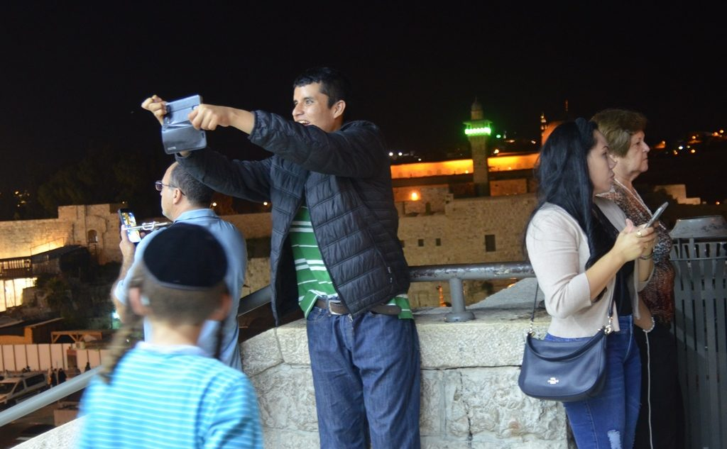 Tourists at night at Kotel taking photos