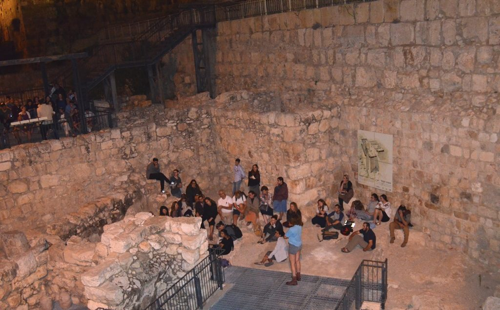 Group hearing about excavations in Old City on Tisha Be'Av night