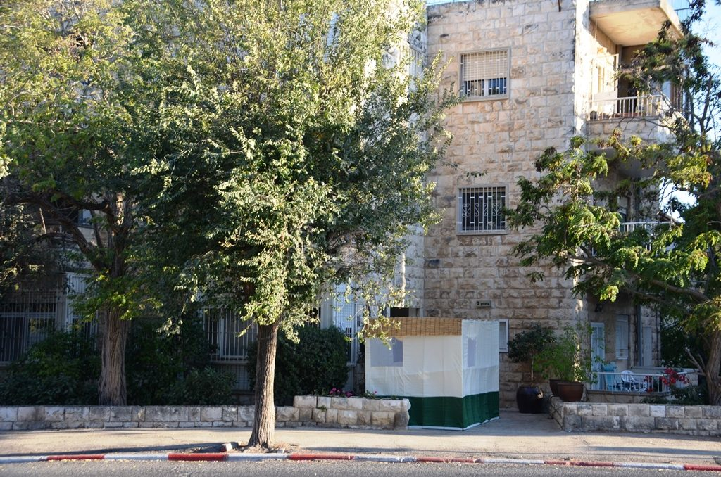Personal sukkah at street level in Jerusalem Israel
