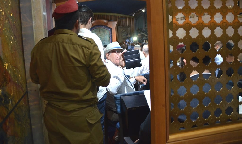 During selihot man taking video at Beit Hanasi