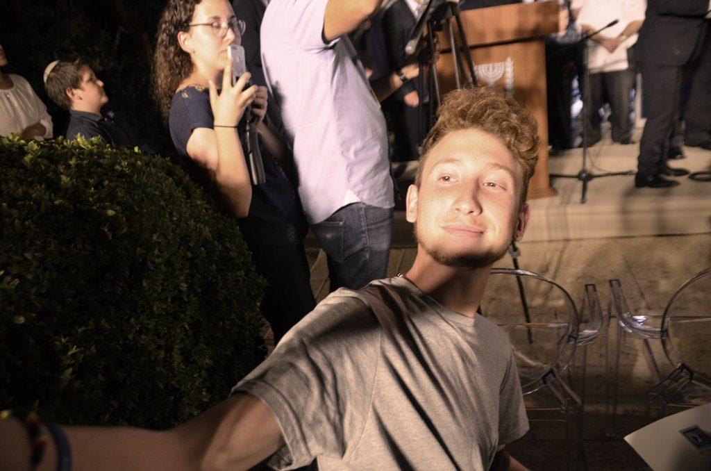 Young man taking selfie at Beit Hanasi with President Rivlin