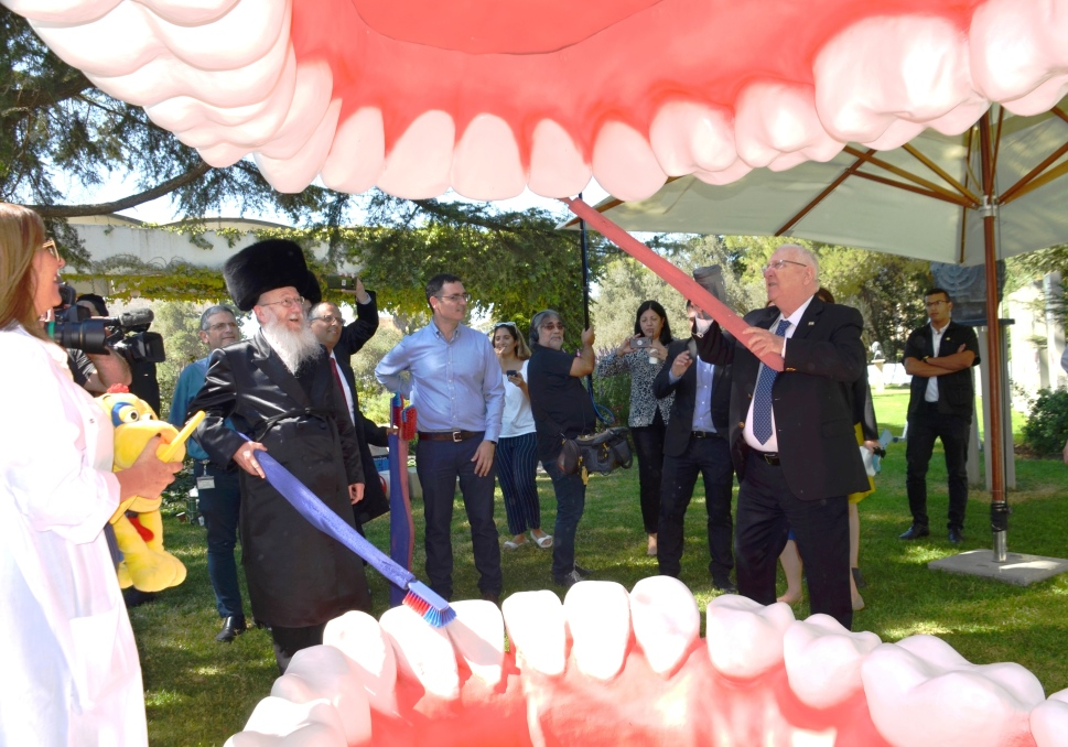 Rivlin and LItzman with giant mouth on sukkot to promote health