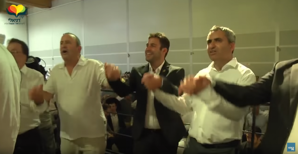 Jerusalem mayor candidates holding hands