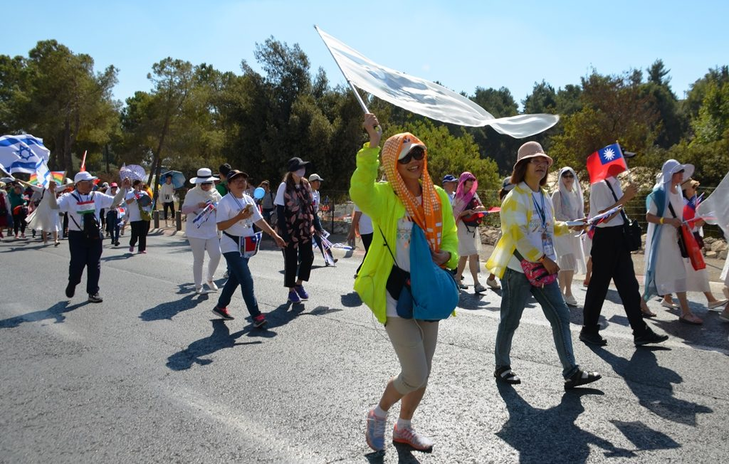 People walking in Jerusalem Parade on Sukkot
